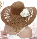 Elegante zomerse feesthoed strandhoed bruin met bloem_