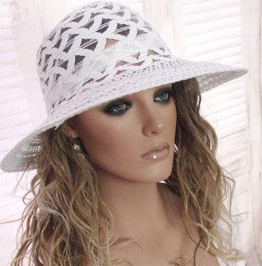 Elegante opengewerkte dameshoed wit